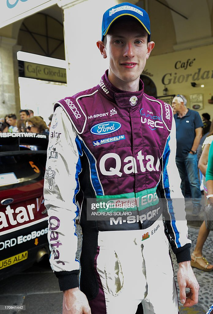 British driver Elfyn Evans poses in front of his Ford Fiesta RS WRC, during the opening ceremony of the FIA World Rally Championship of Italy in Sassari, on the Italian island of Sardinia on June 20, 2013.