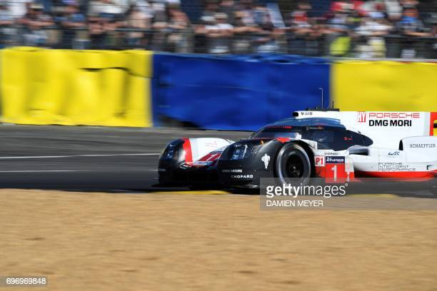 British driver Nick Tandy competes on a Porsche 919 Hybrid N°1 during the 85th Le Mans 24hours endurance race on June 17 2017 in Le Mans western...