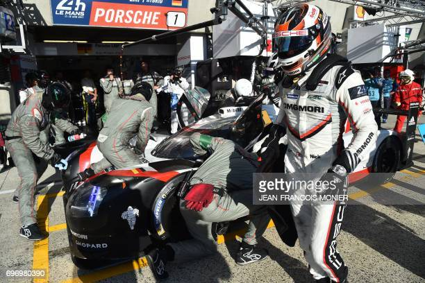 British driver Nick Tandy stands by a Porsche 919 Hybrid N°1 after competing during the 85th Le Mans 24hours endurance race on June 17 2017 in Le...