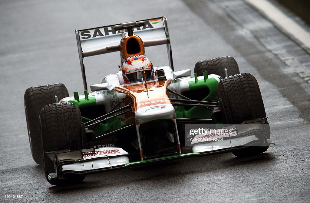 British driver Paul Di Resta drives the Sahara Force India VJM06 Formula 1 racing car during the launch at Silverstone race circuit near Northampton on Febuary 1, 2013. Force India have yet to announce their second driver to join Paul Di Resta.