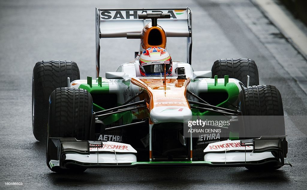 British driver Paul Di Resta drives the Sahara Force India VJM06 Formula 1 racing car during the launch at Silverstone race circuit near Northampton on Febuary 1, 2013. Force India have yet to announce their second driver to join Di Resta.