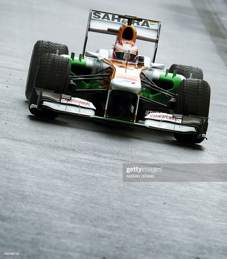 British driver Paul Di Resta drives the Sahara Force India VJM06 Formula 1 racing car during the launch at Silverstone race circuit near Northampton on Febuary 1, 2013. Force India have yet to announce their second driver to join Paul Di Resta. AFP PHOTO / ADRIAN DENNIS