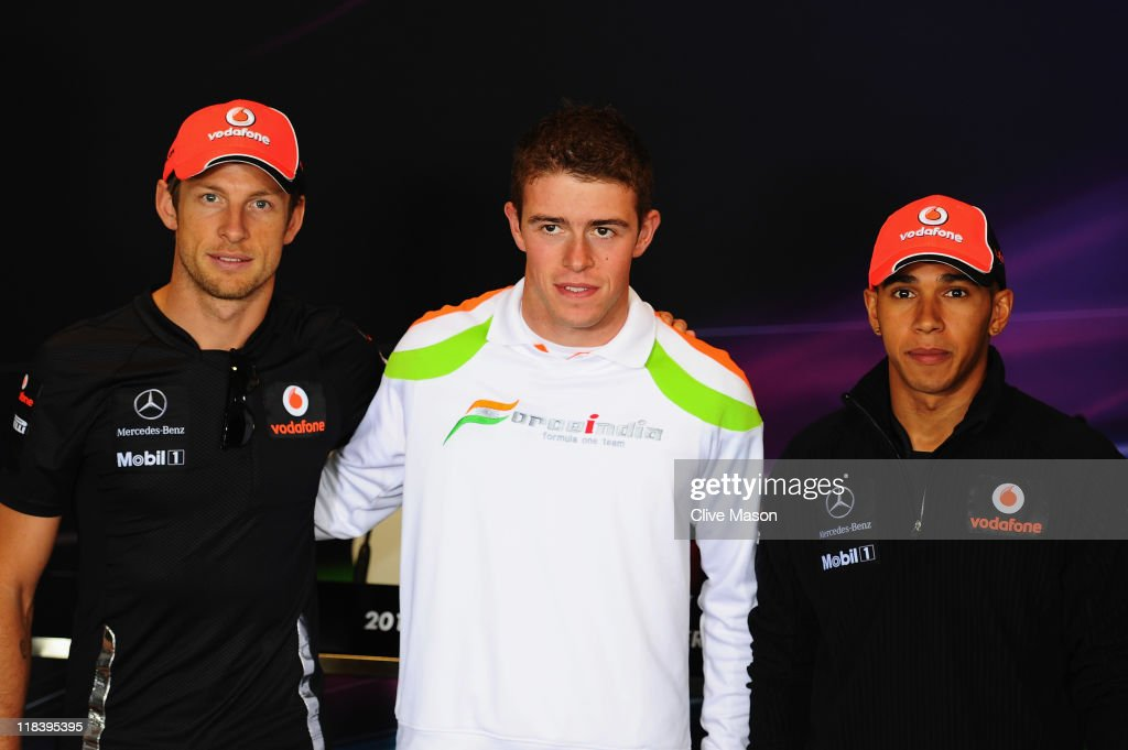 British drivers <a gi-track='captionPersonalityLinkClicked' href=/galleries/search?phrase=Jenson+Button&family=editorial&specificpeople=171505 ng-click='$event.stopPropagation()'>Jenson Button</a> of McLaren, Paul di Resta of Force India and <a gi-track='captionPersonalityLinkClicked' href=/galleries/search?phrase=Lewis+Hamilton&family=editorial&specificpeople=586983 ng-click='$event.stopPropagation()'>Lewis Hamilton</a> of McLaren pose for a photograph before the drivers press conference during previews to the British Formula One Grand Prix at the Silverstone Circuit on July 7, 2011 in Northampton, England.