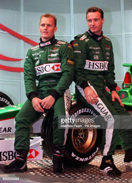 British drivers Johhny Herbert and Eddie Irvine sit on the wheels of the new Jaguar R003 Formula 1 racing car which was unveiled in central London...