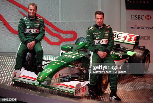 British drivers Johnny Herbert and Eddie Irvine sit on the wheels of the new Jaguar R003 Formula 1 racing car which was unveiled in central London...