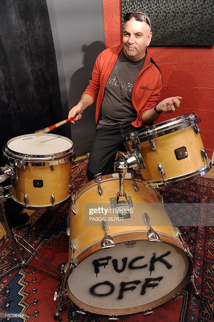 ZAKA - British drummer Neil Conti poses in his studio, on March 30, 2012 in Montpellier, southeastern France. From David Bowie to Mick Jagger, Neil Conti has played with the most famous qrtist in the biggest stadiums prior to landing in Montpellier, where, with his drum, he now accompanies his buddies every Sunday night in a cellar.