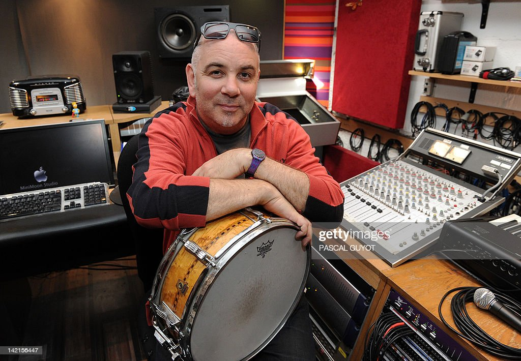 ZAKA - British drummer Neil Conti poses in his studio, on March 30, 2012 in Montpellier, southeastern France. From David Bowie to Mick Jagger, Neil Conti has played with the most famous qrtist in the biggest stadiums prior to landing in Montpellier, where, with his drum, he now accompanies his buddies every Sunday night in a cellar. AFP PHOTO/ PASCAL GUYOT