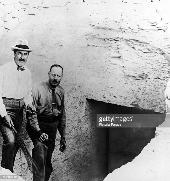 British Egyptologist Howard Carter stands with his assistant Arthur Callender on the steps leading down to the entrance to the tomb of Pharaoh...