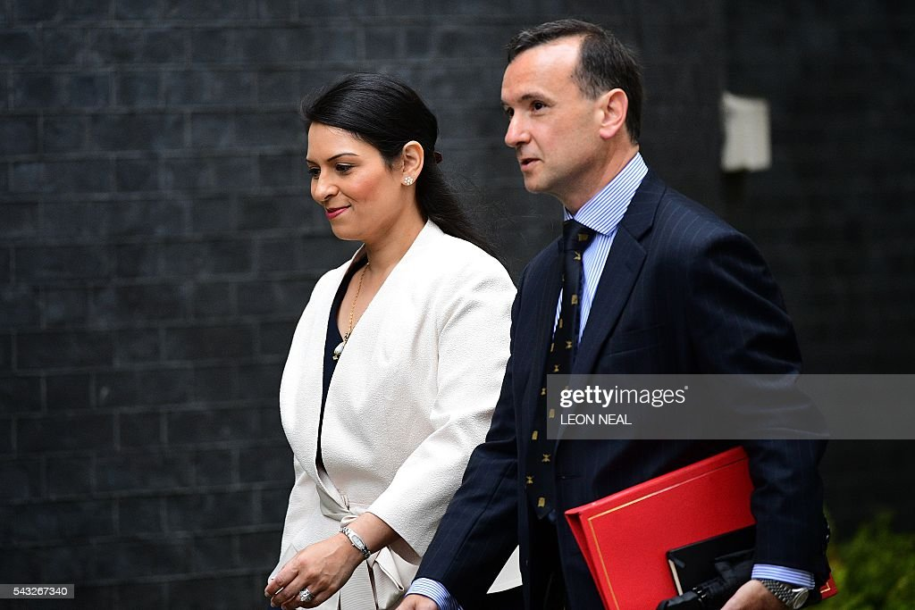 British Employment Minister at the Department for Work and Pensions Priti Patel (L) and British Wales Secretary Alun Cairns arrives to attend a cabinet meeting at 10 Downing Street in central London on June 27, 2016. European stock markets mostly slid Monday as British finance minister George Osborne attempted to calm jitters after last week's shock Brexit referendum. Britain's surprise referendum decision to leave the European Union wiped $2.1 trillion off market valuations on Friday and sent the pound collapsing to a 31-year low against the dollar. / AFP / LEON