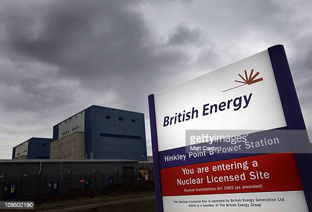 British Energy sign is displayed in front of the old Hinkley Point A's twin Magnox reactors at the Hinkley Point nuclear power station on February 28...