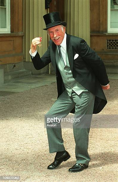 British Entertainer and Comedian Bruce Forsyth OBE Outside Buckingham Palace after receiving the OBE
