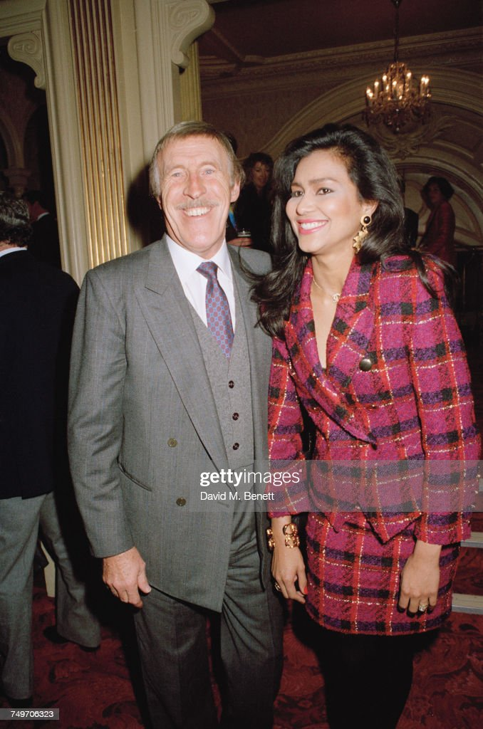 British entertainer Bruce Forsyth (1928 - 2017) with his third wife, Wilnelia Merced, 9th December 1990.