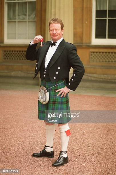 British Entertainer Jim Davidson OBE Outside Buckingham Palace after receiving his OBE