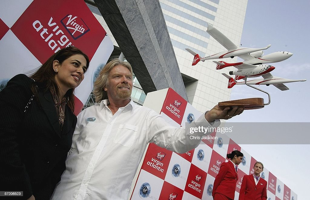British Entrepreneur and businessman Sir Richard Branson and Namira Salim (C), the first Dubai founder Astronaut examine a model of Spaceship One after a Press conference for Virgin's new service Virgin Galactic at Emirates Towers on March 29, 2006 in Dubai, United Arab Emirates. Virgin Galactic plans to offer sub-orbital spaceflights, with the first flights being planned to begin in 2008.