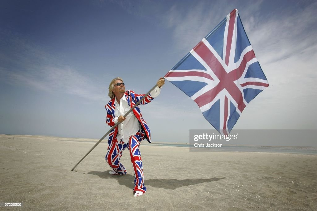British Entrepreneur and businessman Sir Richard Branson poses with a Union Jack during a photocall on a stretch of sand on the man-made island known as 'United Kingdom' in the new development, The World on March 29, 2006 in Dubai, United Arab Emirates. The World consists of over 300 man made islands strategically positioned to form the shape of the world map, lying 4km off the coast of Dubai.