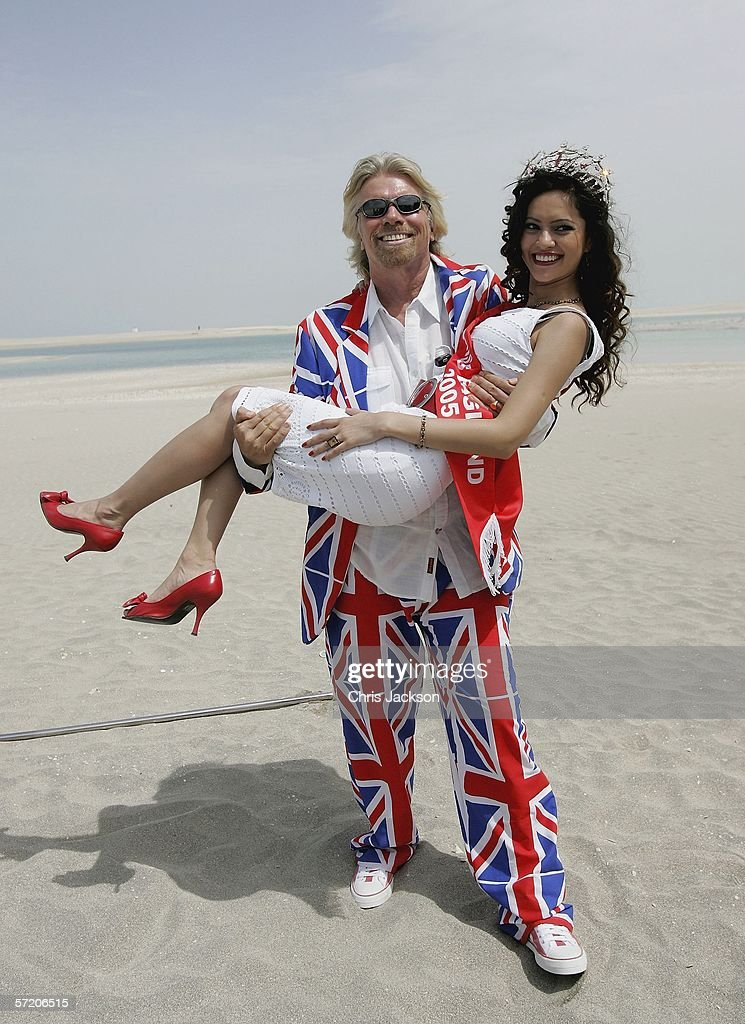British Entrepreneur and businessman Sir Richard Branson poses with Miss England Hammasa Kohistani during a photocall on a stretch of sand on the man-made island known as 'United Kingdom' in the new development, The World on March 29, 2006 in Dubai, United Arab Emirates. The World consists of over 300 man made islands strategically positioned to form the shape of the world map, lying 4km off the coast of Dubai.