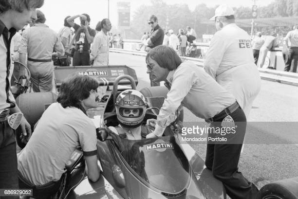British entrepreneur Bernie Ecclestone beside a Brabham BT45 during the qualifying sessions of the Italian Gran Prix Monza 1977