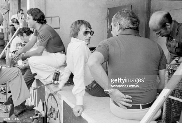 British entrepreneur Bernie Ecclestone chatting in the pits during the qualifying sessions of the Italian Gran Prix Monza 1977