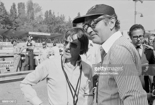 British entrepreneur Bernie Ecclestone talking to a man during the qualifying sessions of the Italian Gran Prix Monza 1977