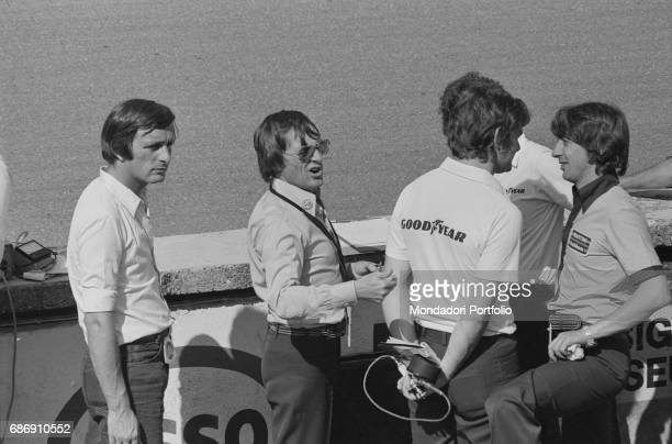 British entrepreneur Bernie Ecclestone talking to the mechanics during the qualifying sessions of the Italian Gran Prix Monza 1977