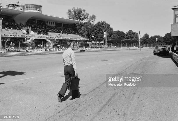 British entrepreneur Bernie Ecclestone walking along the Monza racetrack during the qualifying sessions of the Italian Gran Prix Monza 1977