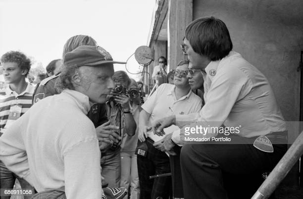 British entrepreneur Bernie Ecclestone with Austrian race car driver Niki Lauda during the qualifying sessions of the Italian Gran Prix Monza 1977