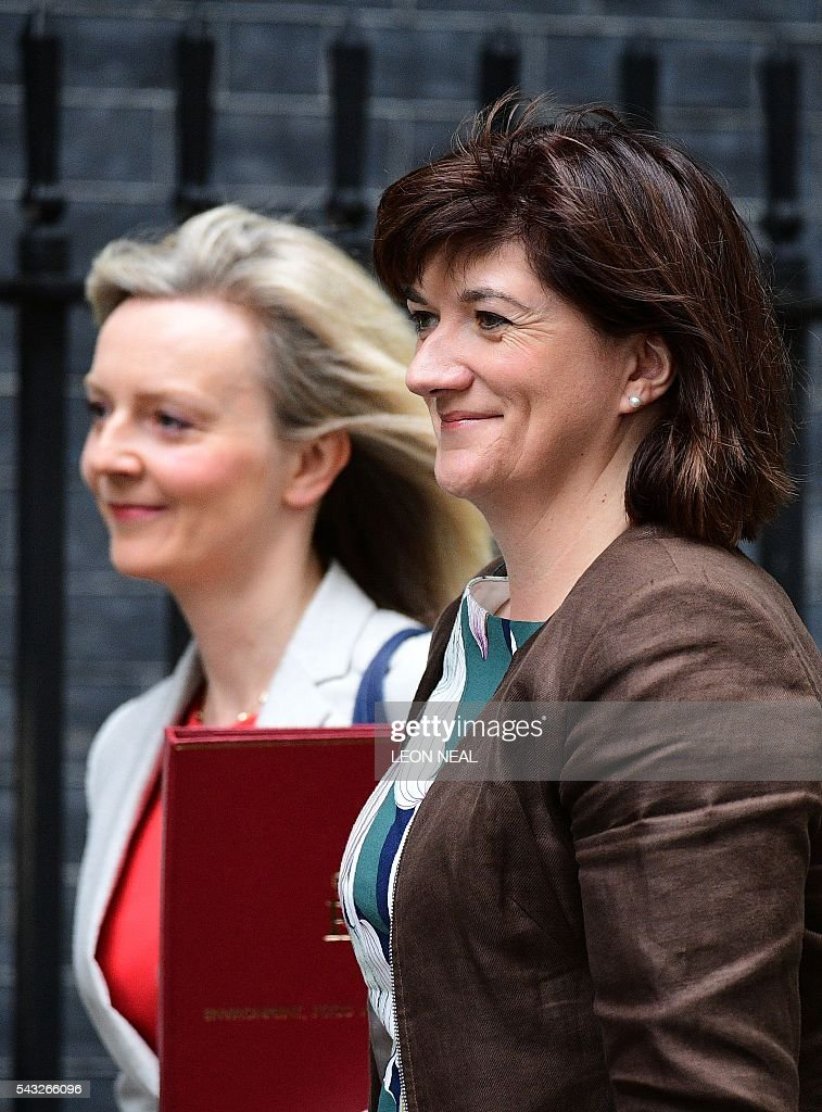British Environment Secretary Liz Truss (L) and British Education Secretary and Minister for Women and Equalities Nicky Morgan arrive to attend a cabinet meeting at 10 Downing Street in central London on June 27, 2016. European stock markets mostly slid Monday as British finance minister George Osborne attempted to calm jitters after last week's shock Brexit referendum. Britain's surprise referendum decision to leave the European Union wiped $2.1 trillion off market valuations on Friday and sent the pound collapsing to a 31-year low against the dollar. / AFP / LEON