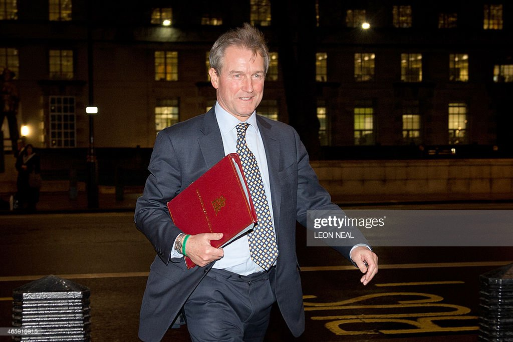British Environment Secretary Owen Paterson arrives at the Cabinet Office ahead of the Cabinet Office Briefing Room meeting in London on January 30...