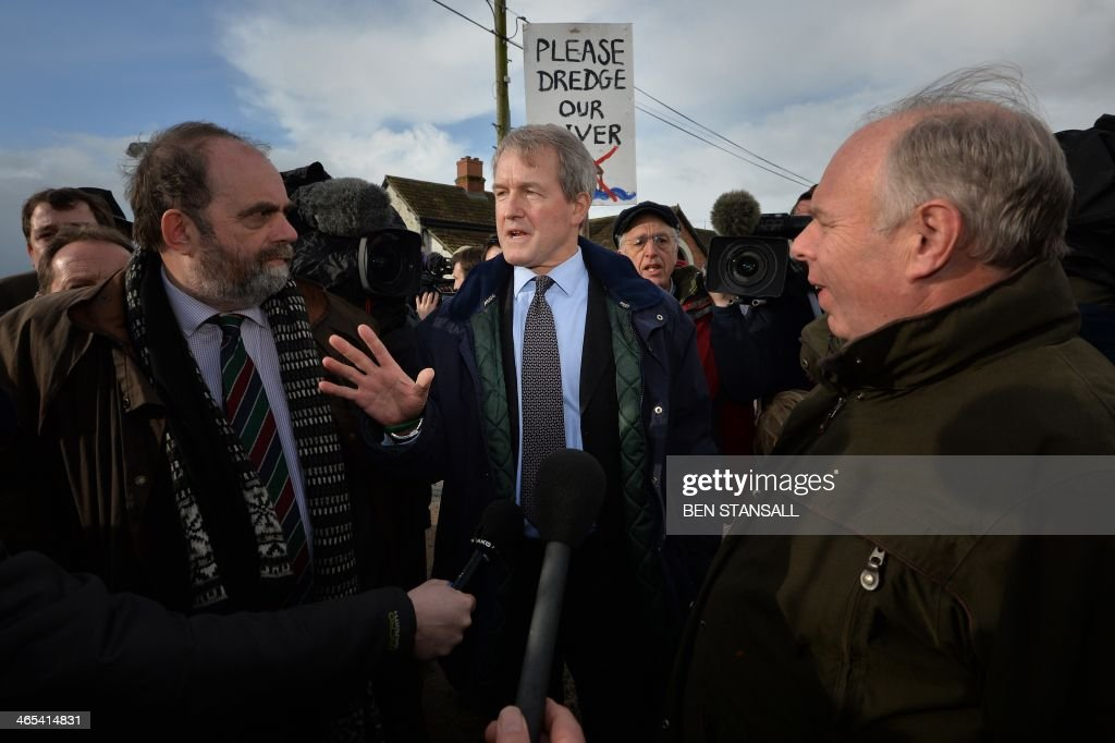 British Environment Secretary Owen Paterson talks with local people during a visit to North Moor pumping station in Moorland in flood hit Somerset...
