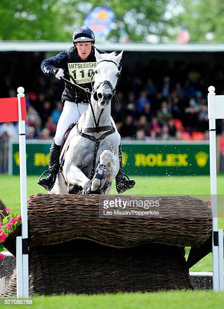 British equestrian Oliver Townend riding Flint Curtis tackles a fence during the cross country phase to win the three day event at the 2009...