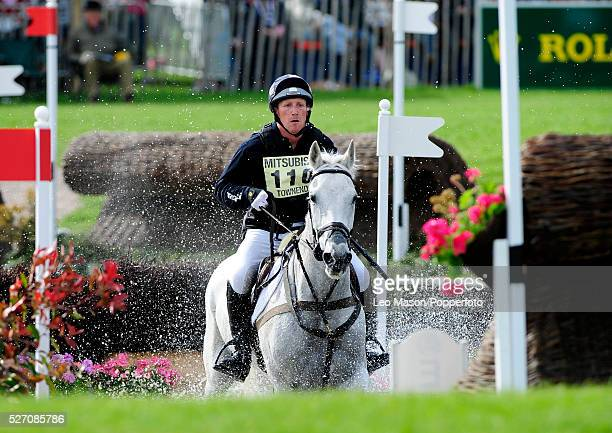 British equestrian Oliver Townend riding Flint Curtis tackles the lake complex during the cross country phase to win the three day event at the 2009...