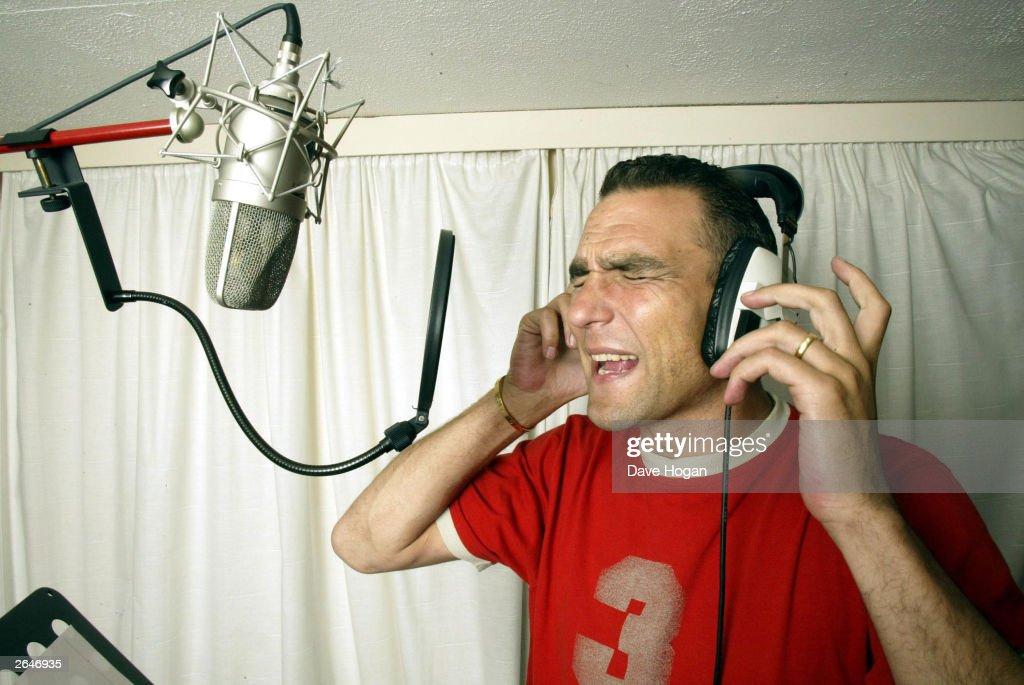 British ex-footballer Vinnie Jones records his new album at his London recording studio on November 18, 2002 in London.