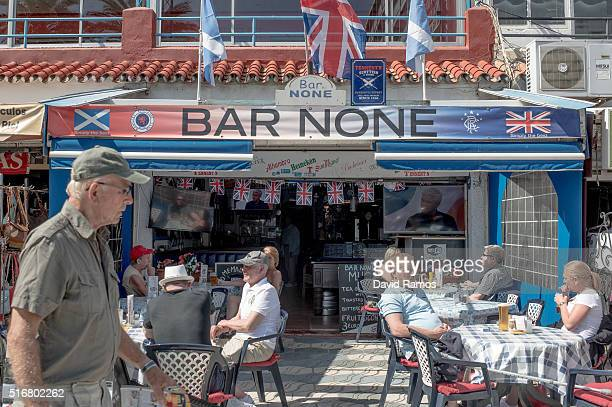British expats and tourists enjoy the atmosphere in a terrace of an English bar on March 17 2016 in Benalmadena Spain Spain is Europe's top...