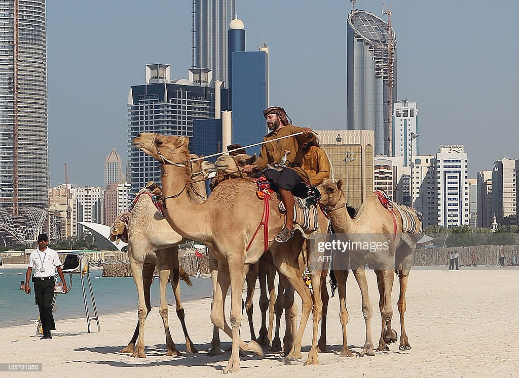 British explorers Adrian Hayes arrives at his final destination in Abu Dhabi on December 13 2011 after completing with two UAE nationals a 44day trek...