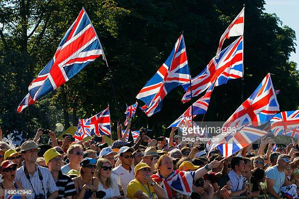 British fans celebrate during the twentieth and final stage of the 2012 Tour de France from Rambouillet to the ChampsElysees on July 22 2012 in Paris...