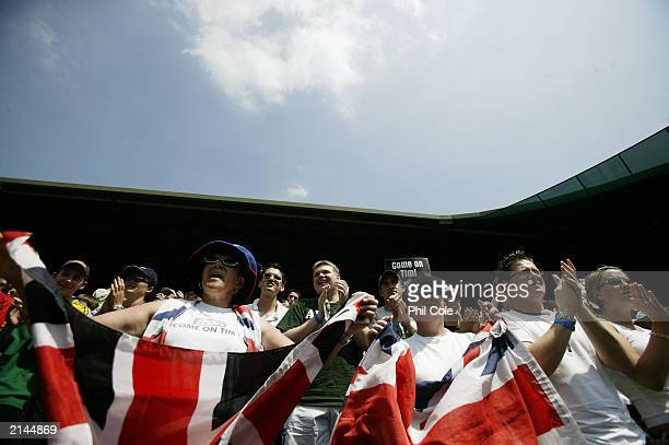 British fans cheer on Tim Henman of Great Britain on Centre Court during day four of the Wimbledon Lawn Tennis Championships held on June 26 2003 at...
