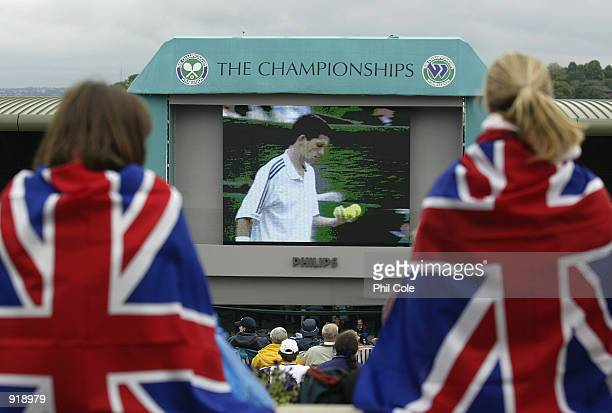 British fans on 'Henman Hill' watching Tim Henman of Great Britain in action against Lleyton Hewitt of Australia at the All England Tennis...
