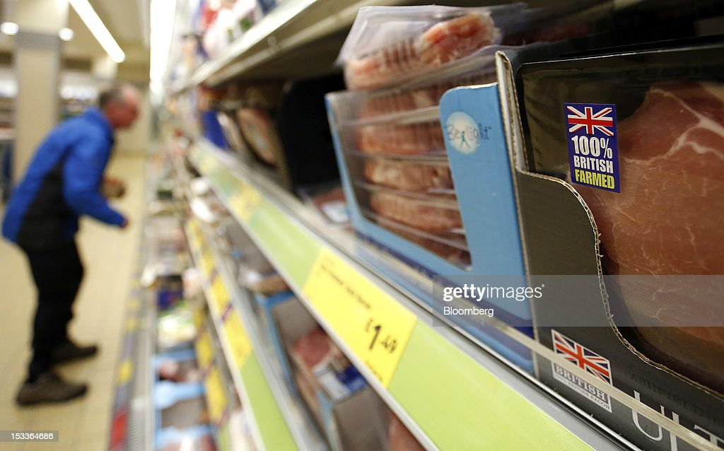 A 100% British Farmed logo is displayed on a packet of bacon at a supermarket operated by Aldi Group, Germany's biggest discount-food retailer, in Manchester, U.K., on Thursday, Oct. 4, 2012. U.K. shop-price inflation slowed in September as retailers offered discounts to attract cash-strapped consumers, the British Retail Consortium said. Photographer: Paul Thomas/Bloomberg via Getty Images