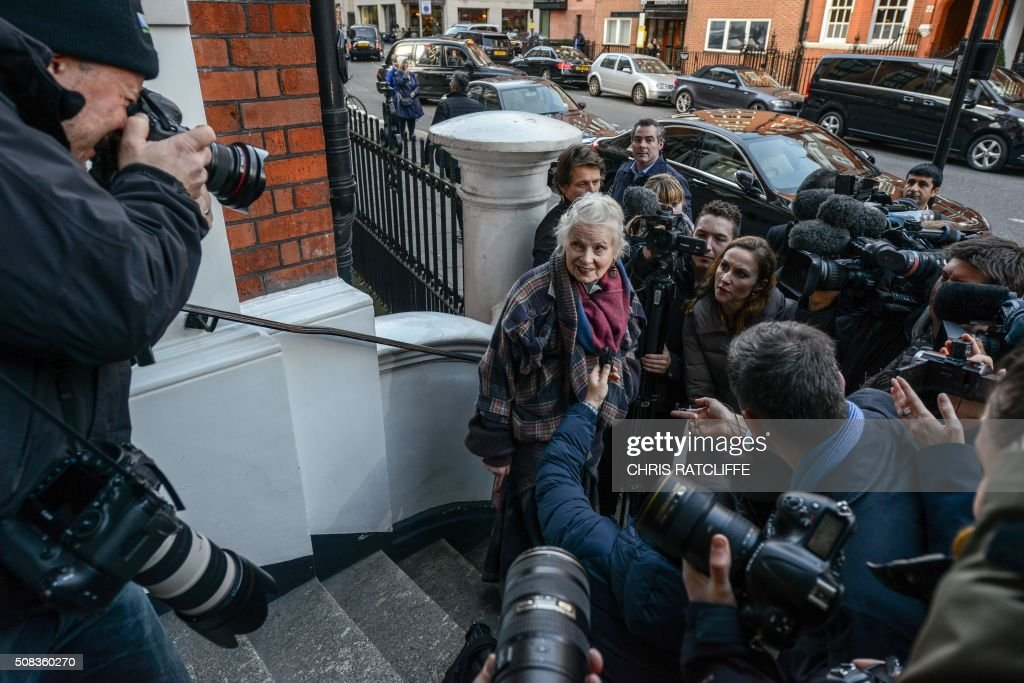 British fashion designer and activist Vivienne Westwood is surrounded by media as she leaves the Ecuadorian embassy in central London on February 4...