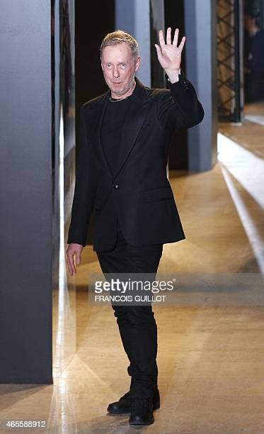 British fashion designer Bill Gaytten acknowledges the audience at the end of the John Galliano the 20152016 fall/winter readytowear collection...