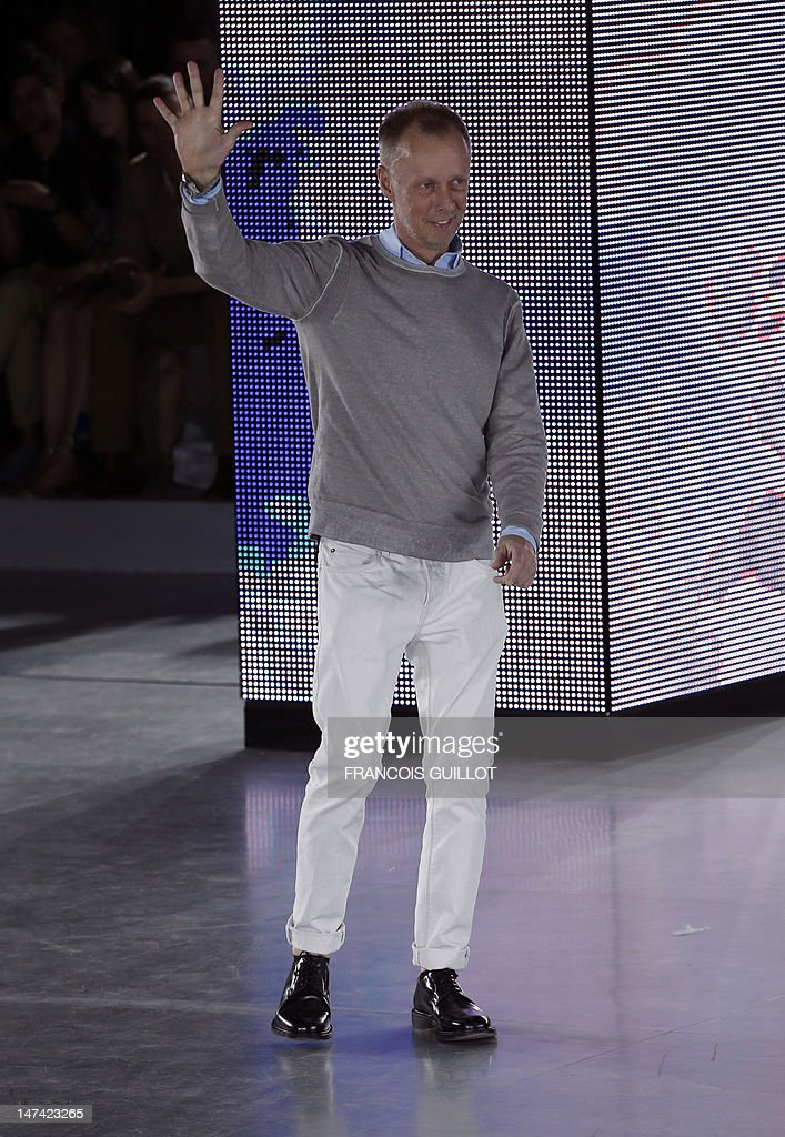 British fashion designer Bill Gaytten for the label John Galliano fashion house acknowledges the audience following the men's spring-summer 2013 fashion collection show on June 29, 2012, in Paris.