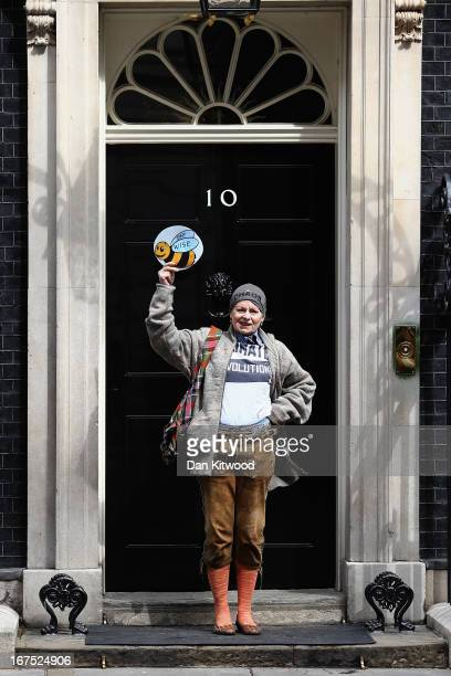 British fashion designer Dame Vivienne Westwood hands in a petition to 10 Downing Street on April 26 2013 in London England Over a hundred...