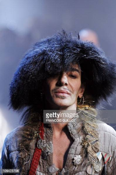 British fashion designer John Galliano is pictured at the end of his Men's fallwinter 20112012 readytowear collection show on January 21 2011 in...