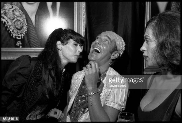 British fashion designer John Galliano shares a joke at Saks 5th Avenue on September 9 1996 in New York City New York