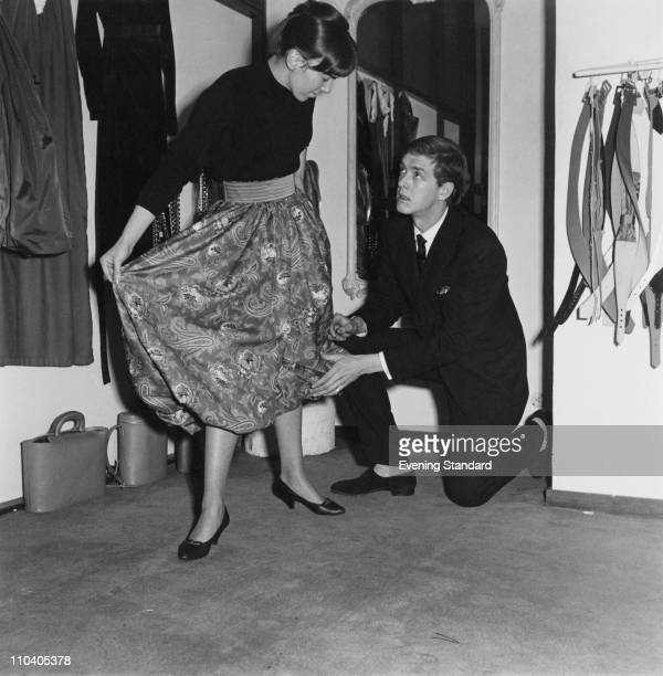 British fashion designer Mary Quant and her husband Alexander Plunkett Greene at Quant's shop Bazaar on the King's Road Chelsea London 29th December...
