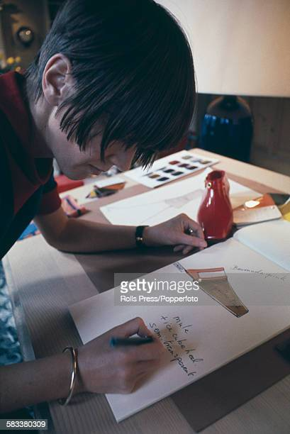 British fashion designer Mary Quant pictured at work designing a semi transparent shoe at a drawing table in her design studio in London in October...