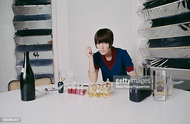 British fashion designer Mary Quant pictured at work testing perfumes in her design studio in London in October 1967
