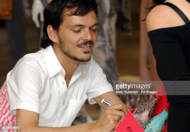 British fashion designer Matthew Williamson during a signing of The Summer Icon Collection a set of three limited edition CocaCola bottles he...