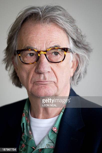 British fashion designer Paul Smith addresses journalists during a press conference at the opening of the 'Hello My Name is Paul Smith' exhibition at...