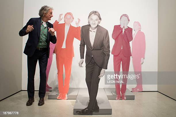 British fashion designer Paul Smith poses for pictures with cardboard models of himself at a photocall to launch the 'Hello My Name is Paul Smith'...